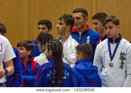 BERLIN - MARCH 18 2017: The team of Armenia is pleased with the victory of the fighter. European championship Kyokushin World Union (KWU) for Children and Youth.