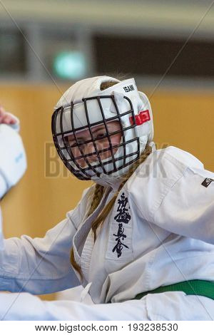 BERLIN - MARCH 18 2017: Young fighter in protective helmets. European championship Kyokushin World Union (KWU) for Children and Youth.