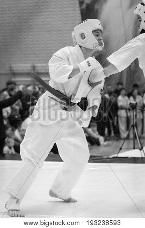 BERLIN - MARCH 18 2017: Fighters on the tatami. black and white. European championship Kyokushin World Union (KWU) for Children and Youth.