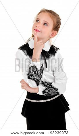 Portrait of thinking school girl child in uniform isolated on a white background education concept
