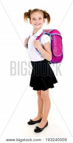 Portrait of smiling school girl child with backpack in uniform isolated on a white background