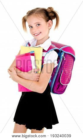 Portrait of smiling school girl child with backpack and books in uniform isolated on a white background