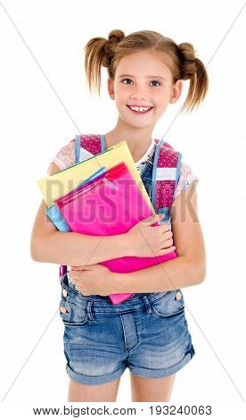 Portrait of smiling school girl child with school bag and books isolated on a white background education concept
