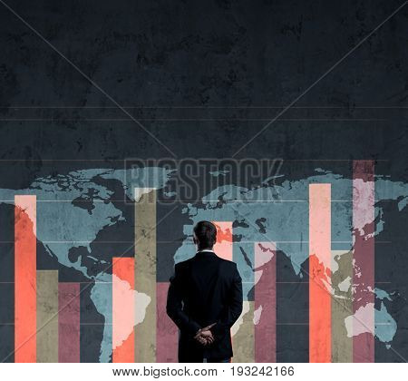 Businessman standing over diagram. World map background. Business, globalization, worldwide concept.
