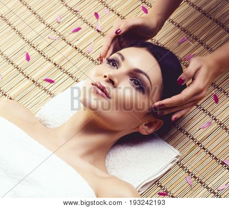 Young and healthy woman getting spa treatment in massaging salon. Aging, rejuvenation and treatment concept.