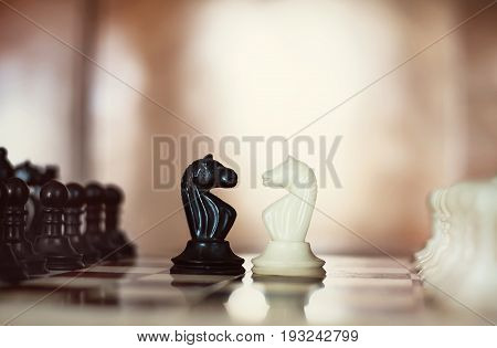 Chess Pieces Knights Facing Each Other For A Standoff