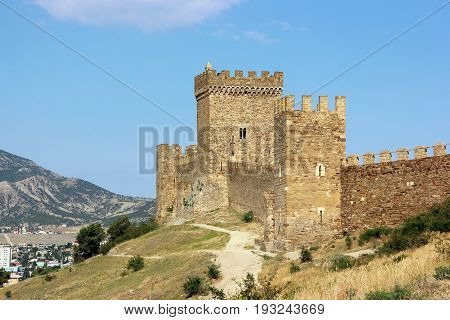 Medieval fortress on the hill overlooking the modern city. Genoese fortress Sudak Crimea.
