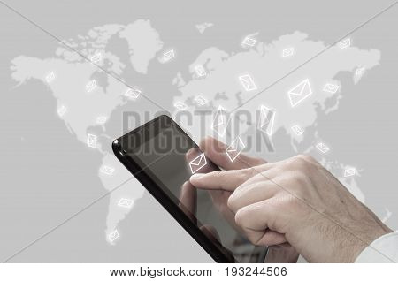 The concept of email marketing. Businessman makes sending emails from your tablet.