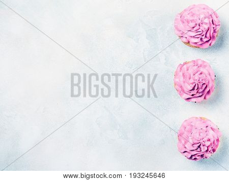 Pink cupcakes with roses and cherries. Festive and bright. Wedding Celebration concept