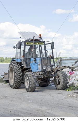 NIZHNY NOVGOROD, RUSSIA June 28, 2017 : Auto appliances communal services of the city. City tractor Belarus, universal machine.  NIZHNY NOVGOROD