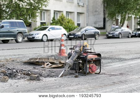 NIZHNY NOVGOROD, RUSSIA June 28, 2017 : Auto appliances communal services of the city. A hand tool for repairing the roadway. Electro hammer Devolt and diesel unit. RUSSIA
