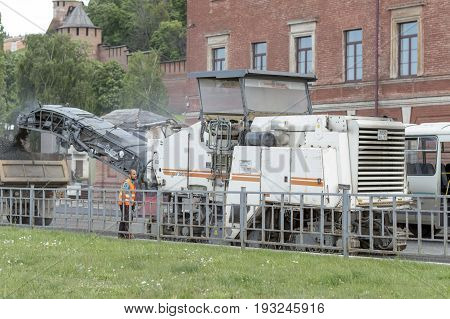 NIZHNY NOVGOROD, RUSSIA June 28, 2017 : Auto appliances communal services of the city. The  Auto appliances for collecting old asphalt and loading into the truck kamaz. NIZHNY NOVGOROD