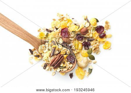 Tasty homemade muesli with nuts in wooden spoon isolated on white background.
