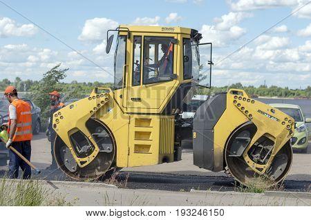 NIZHNY NOVGOROD, RUSSIA June 28, 2017 : Auto appliances communal services of the city. Mechanical machine for compacting new asphalt on the road surface. NIZHNY NOVGOROD