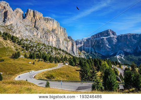 Picturesque road through the Sella Pass, Dolomites. The concept of extreme and ecological tourism. Impressive ridge of dolomite rocks.