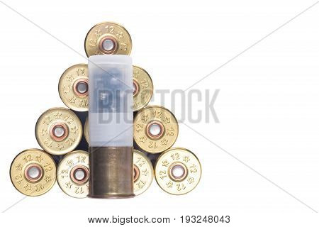 Ammunition for hunting lie in heap on white background isolated