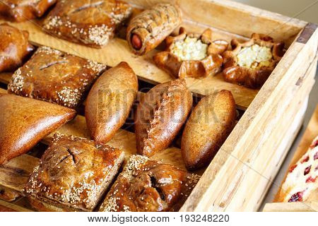 Freshly baked bread and puffson tray. morning pastries at the bakery or cafe