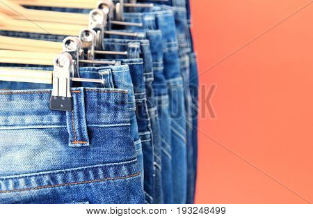 Close up of row of hanged blue jeans