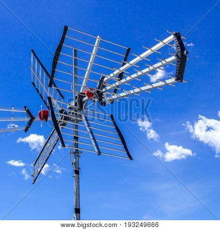 TV antenna for receiving terrestrial television UHF band against the blue sky