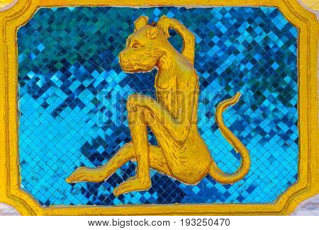 Golden monkey embossed cement decorated in temple.