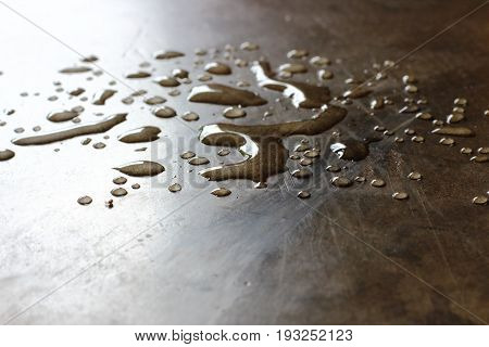 Abstract background of water drops on concrete floor in the room.