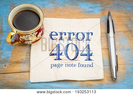 error 404 - web page not found sign -handwriting on a napkin with a cup of coffee