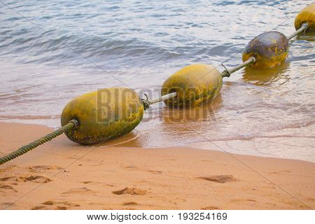 Sea yellow buoys Safe Swimming zone separator.