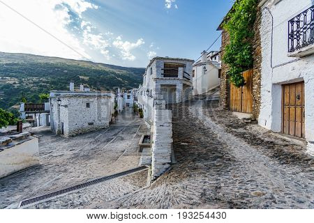 Wide angle view of street in Capileira, Granada, Spain
