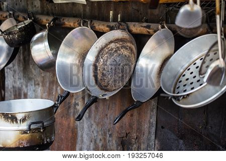 Old grungy dirty kitchenware in rural country kitchen unhealthy.