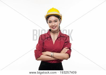 Asian woman engineer in red shirt and yellow safety cap crossing arms with happy emotion. People gesturing in business and enginerring concept