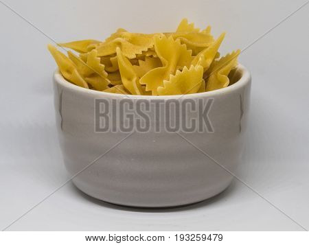 pile of yellow farfale in the grey cup