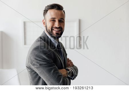 Portrait Of Cheerful Businessman With Arms Crossed Looking At Camera