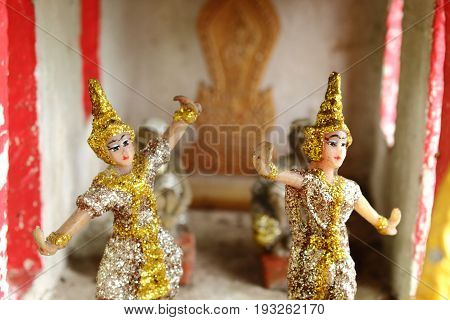 Thai folk dancer doll in the spirit house.