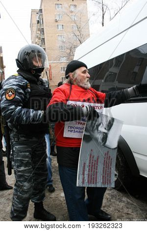 Moscow, Russia - December 27 2010. Outside the courthouse police detain protesters in support of Mikhail Khodorkovsky