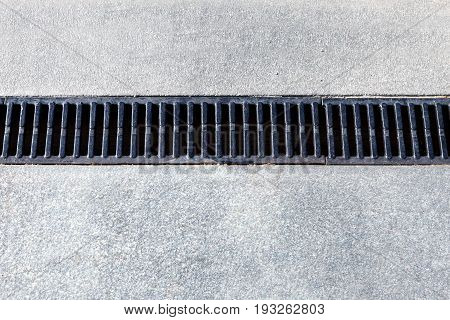 Modern drainage system. The drain on the road or the sidewalk