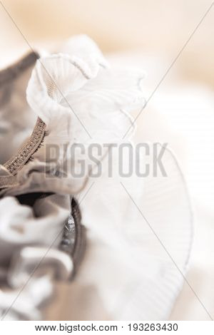 Bride's garter. Bride's traditional symbolic accessory. Grey laces with bows. Close up.