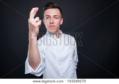 Male Cook Posing With Fingers Crossed
