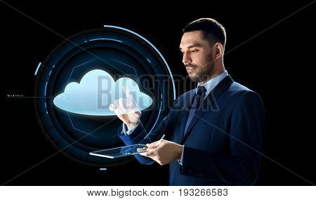 business, people, cloud computing and modern technology concept - businessman in suit working with transparent tablet pc computer and virtual projection over black background