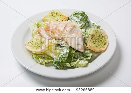 Caesar Salad With Chicken On White Plate.