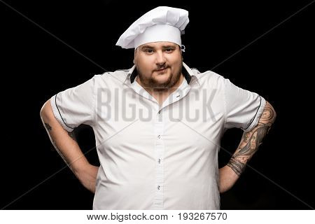 Professional Young Chef Posing In White Hat Isolated On Black