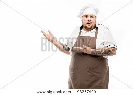 Shocked Chef Pointing Away And Looking At Camera Isolated On White