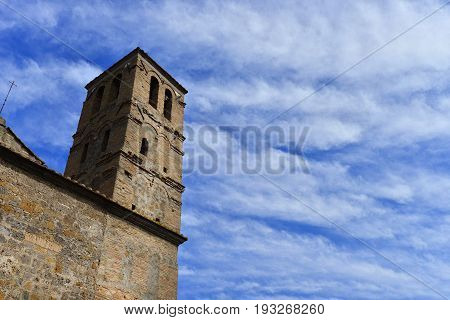 Medieval belfry of the Church of San Giuliano with clouds in the center of the ancient ruined of Faleria a small city near Rome