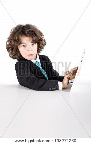 Cute Kinky Businessman Sitting Half-turned, Looking At The Camera. It Works With The Tablet. Close-u
