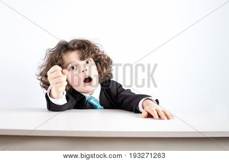 Small Businessman Clenching His Fist And Screaming Looking At The Camera. Close-up. White Background