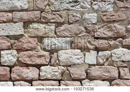 Wall made from stones of the Mount Subasio in Italy