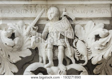 Planet Mars as knight with Aries and Scorpio zodiac signs ancient medieval relief on Venice Doge Palace column