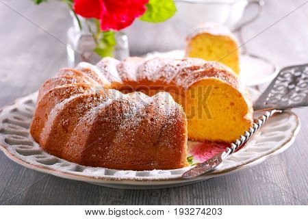 Lemon Chiffon Cake with icing sugar on top sliced