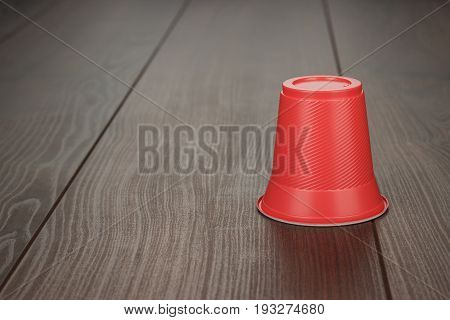 disposable red plastic cup. red plastic cup on brown table. red plastic cup on the wooden background. plastic party cup for beverage