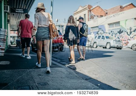 MELBOURNE, AUSTRALIA - March 12, 2017: People walking along the street watching graffiti walls in Melbourne, Australia.