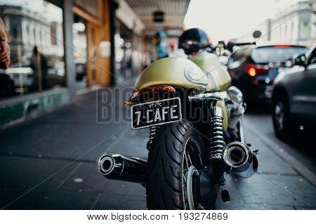 MELBOURNE, AUSTRALIA - March 12, 2017: Sports custom motorbike parked on the sidewalk in the street in Melbourne, Australia.